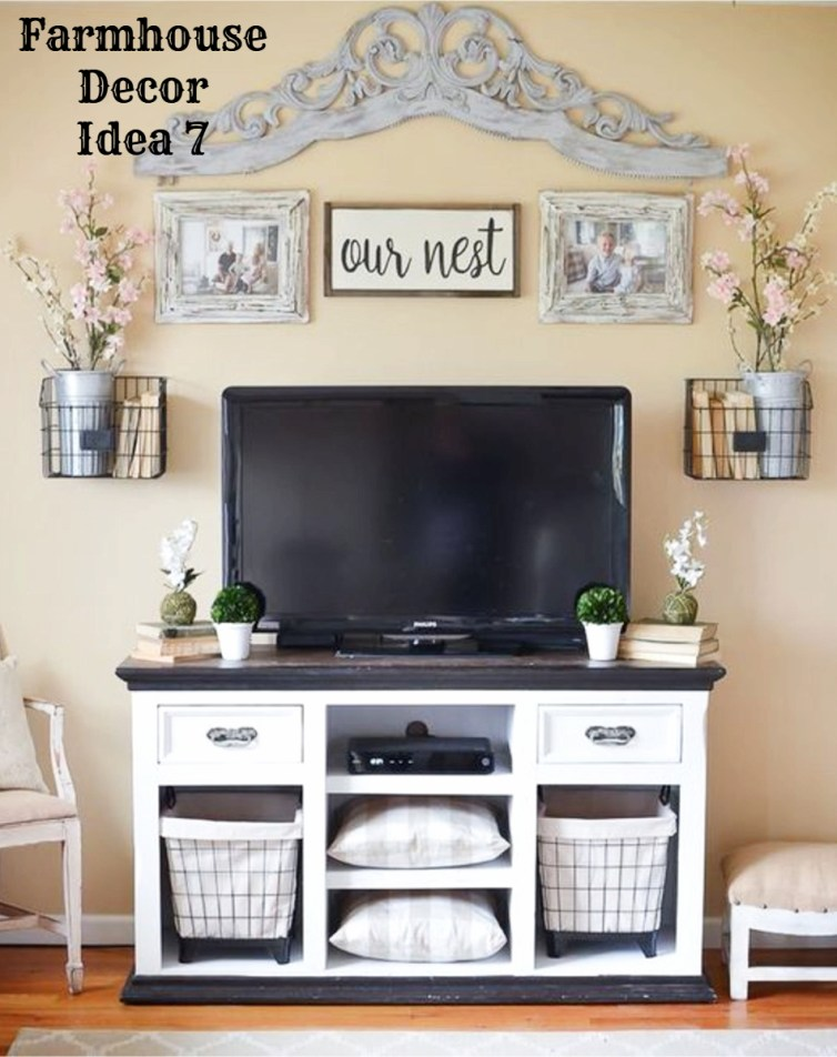 Farmhouse style entertainment cabinet for the living room - love the gallery wall above the tv and that rustic cabinet with baskets is gorgeous - Clutter-free Farmhouse Decor Ideas