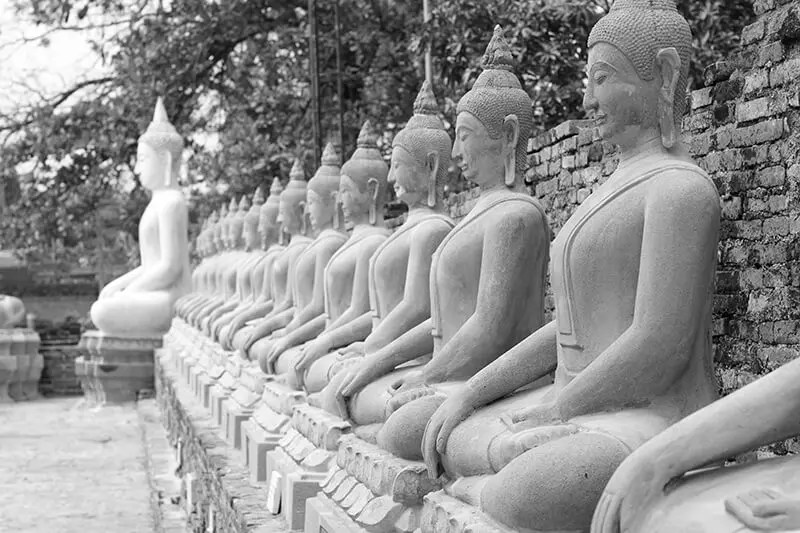 Buddhist statues seated next to one another
