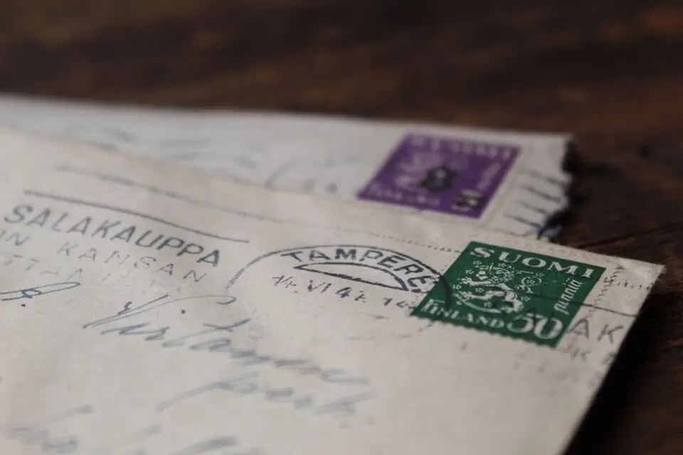 Closeup of two stamped cards in envelopes