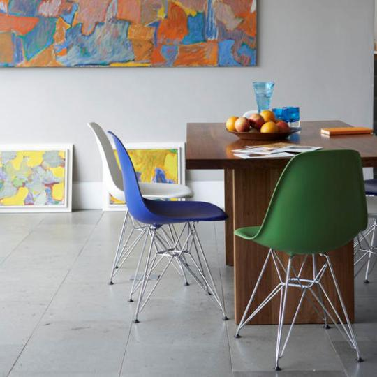 Colorful Dining Room with Multicolored Chairs