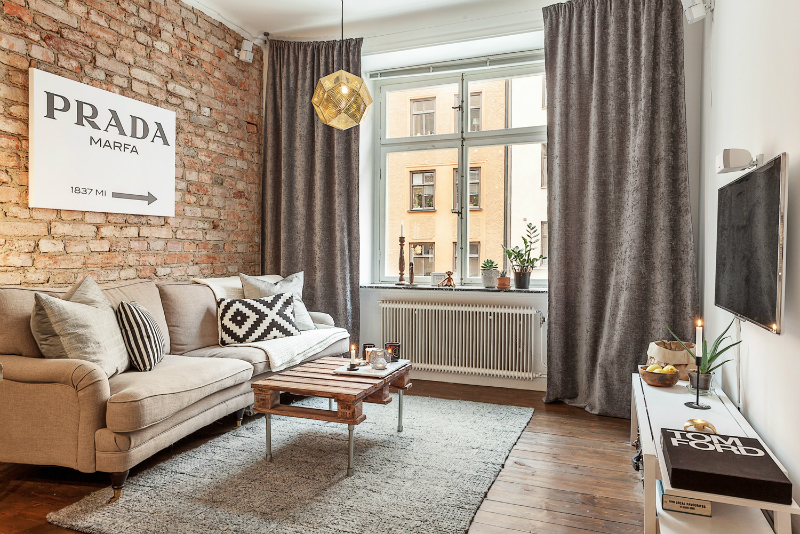 Small Stylish Apartment That Looks Warm Cozy And Inviting