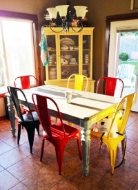 Colorful dining chairs with round glass dining table