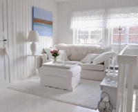 Small country chic living room with simple furniture ...
