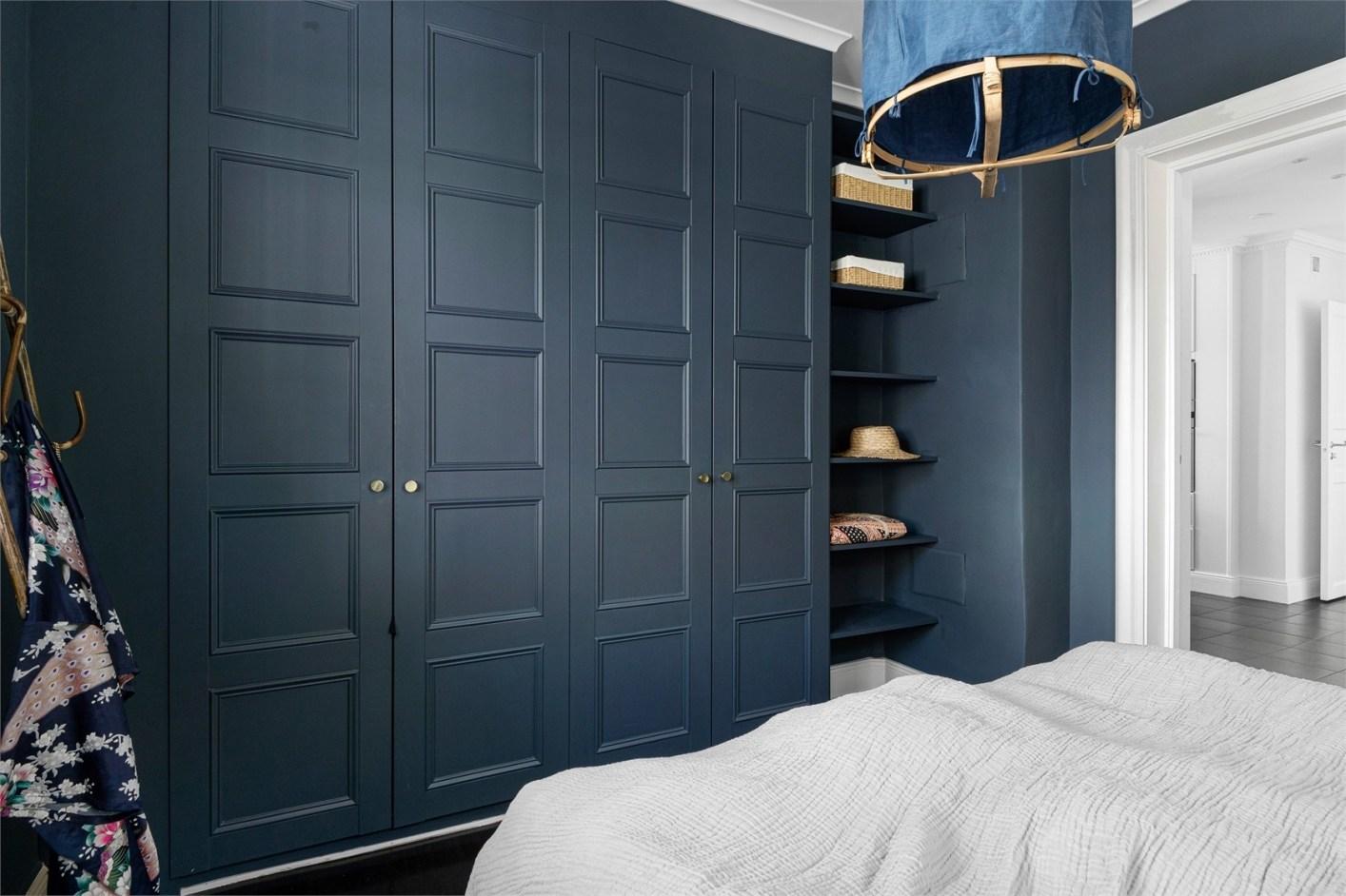 bedroom dark blue wardrobe