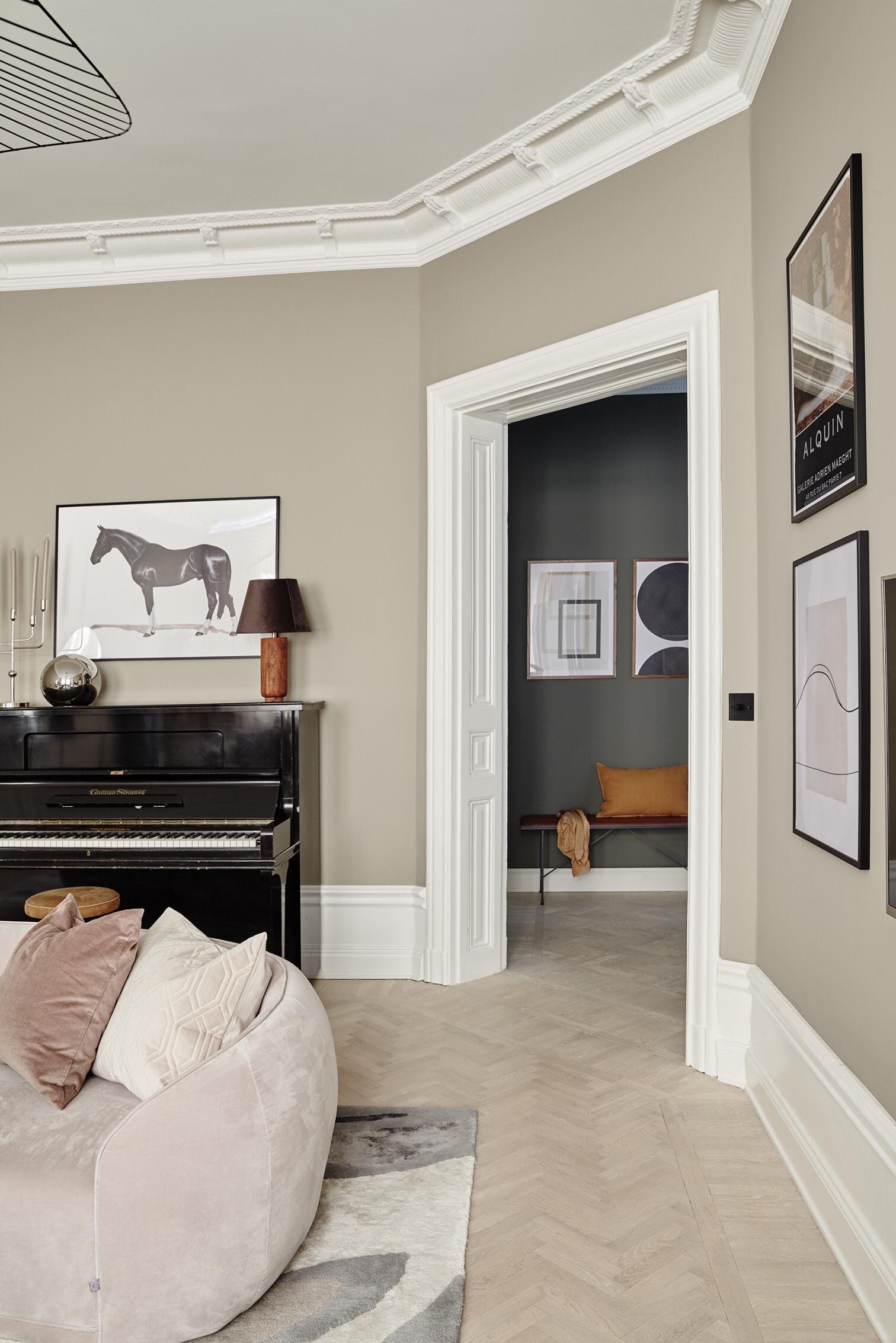living room piano and doorway