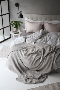Grey and a bit of pink. Soft and sweet bedroom
