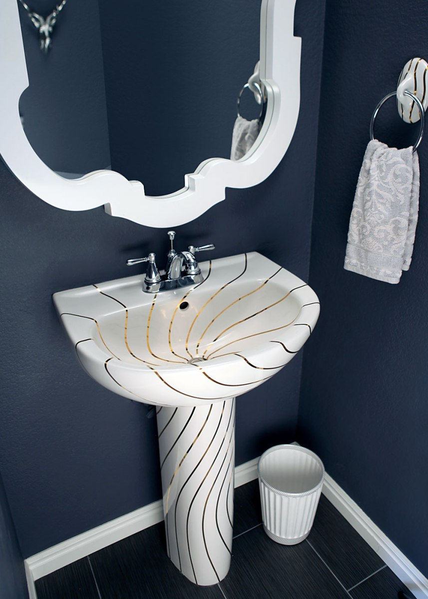 Swirling Gold Lines Sink In A Navy Blue Powder Room
