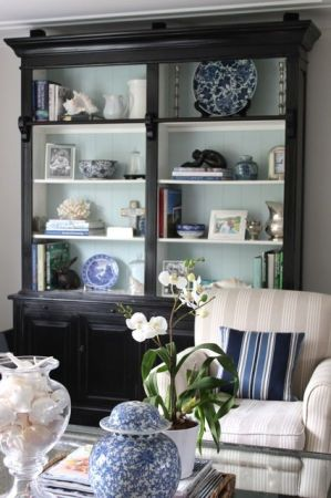 blue painted bookcase backing