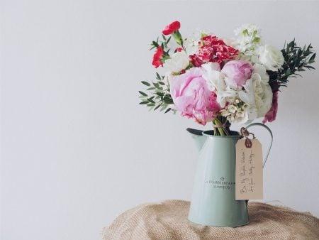 flowers in blue jar