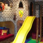 Castle Playroom Design With Yellow Slide