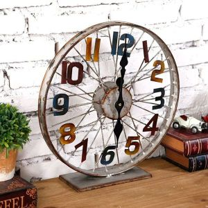 Bike Wheel Clock features Old Metal Wrought Iron Bicycle Clock