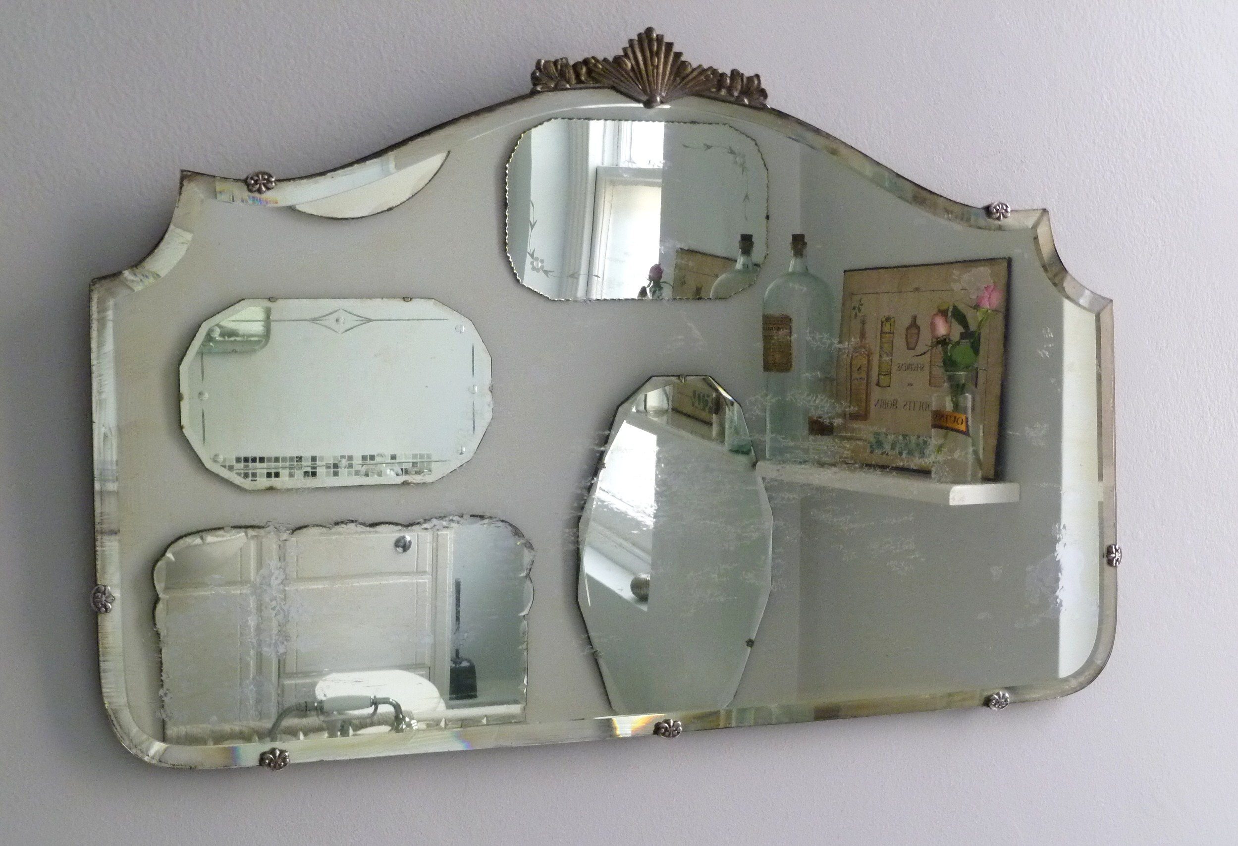 How to hang a display of vintage mirrors  Decorators