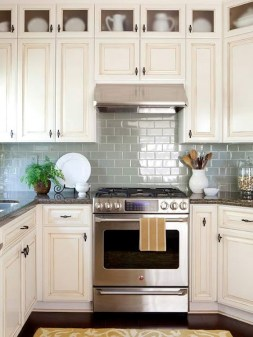Awesome Cream Kitchen Cabinets With Dark Countertops