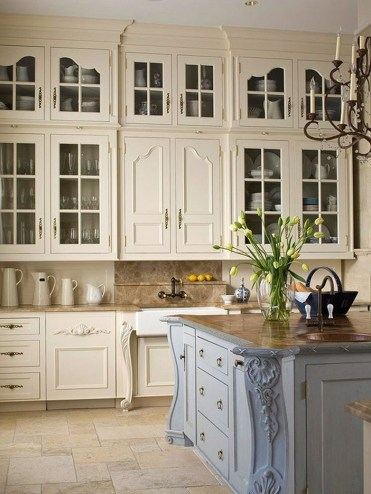 Cream Kitchen Cabinets With Brown Granite Countertops