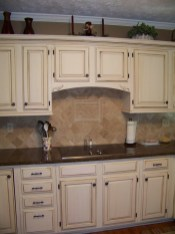 Cream Kitchen Cabinets With Dark Granite Countertops
