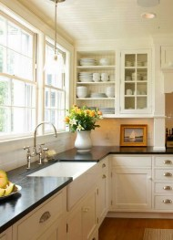 Cream Kitchen Cabinets With Dark Granite