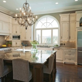 Cream Kitchen Cabinets With Dark Wood Floors