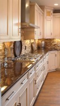 Cream Kitchen Cabinets With Glosy Brown Countertops