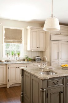Cream Kitchen Cabinets With Granite Countertops and Sink