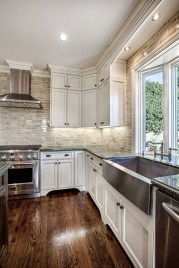 Cream Kitchen Cabinets With Stainless Steel Appliances