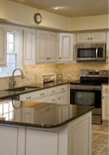 Cream Kitchen Cabinets With Tile Floor and Granite Countertops