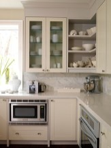Cream Kitchen Cabinets With White Appliances (2)