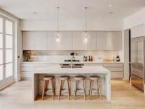 Cream Kitchen Cabinets With White Granite Countertops