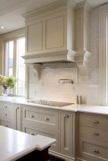 Cream Kitchen Cabinets With White Subway Tile