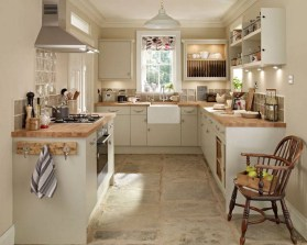 Cream Kitchen Cabinets With Wood Brown Countertops