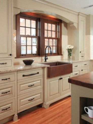 Cream Kitchen Cabinets With Wood Floors and Wood Color Countertops