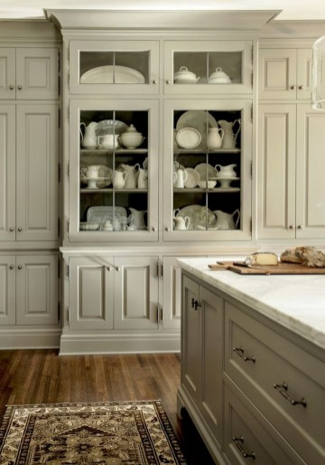 Elegant Cream Kitchen Cabinets With White Granite Countertops