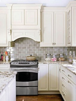 Kitchen Cream Cabinets Dark Wood Floors and backsplash