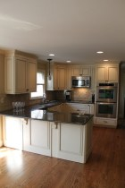 Large Kirchen Cream Cabinets With Wood Floors
