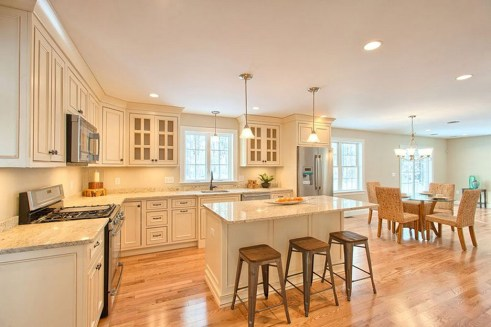 Large Kitchen Cream Cabinets With White Granite Countertops