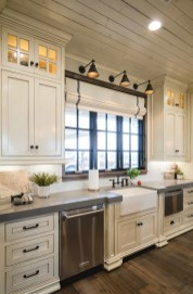 Farmhouse Kitchen Cream Cabinets with natural lighting