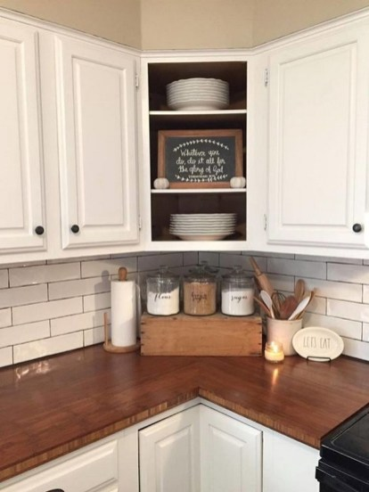 Farmhouse Kitchen With Beadboard Cabinets