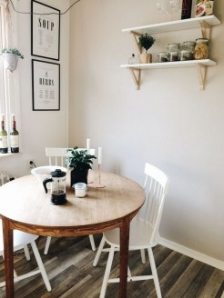Small Round Kitchen Tables and Three White Chairs