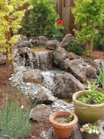 Creative Backyard Ponds Ideas With Waterfalls To Try 20