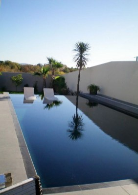 Elegant Black Swimming Pool Design Ideas That All Men Must Know 15