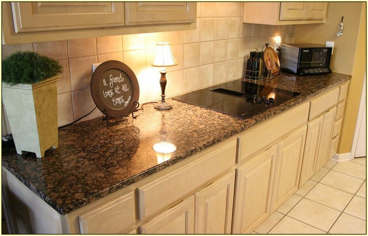 Kitchens With Brown Cabinets And White Countertops