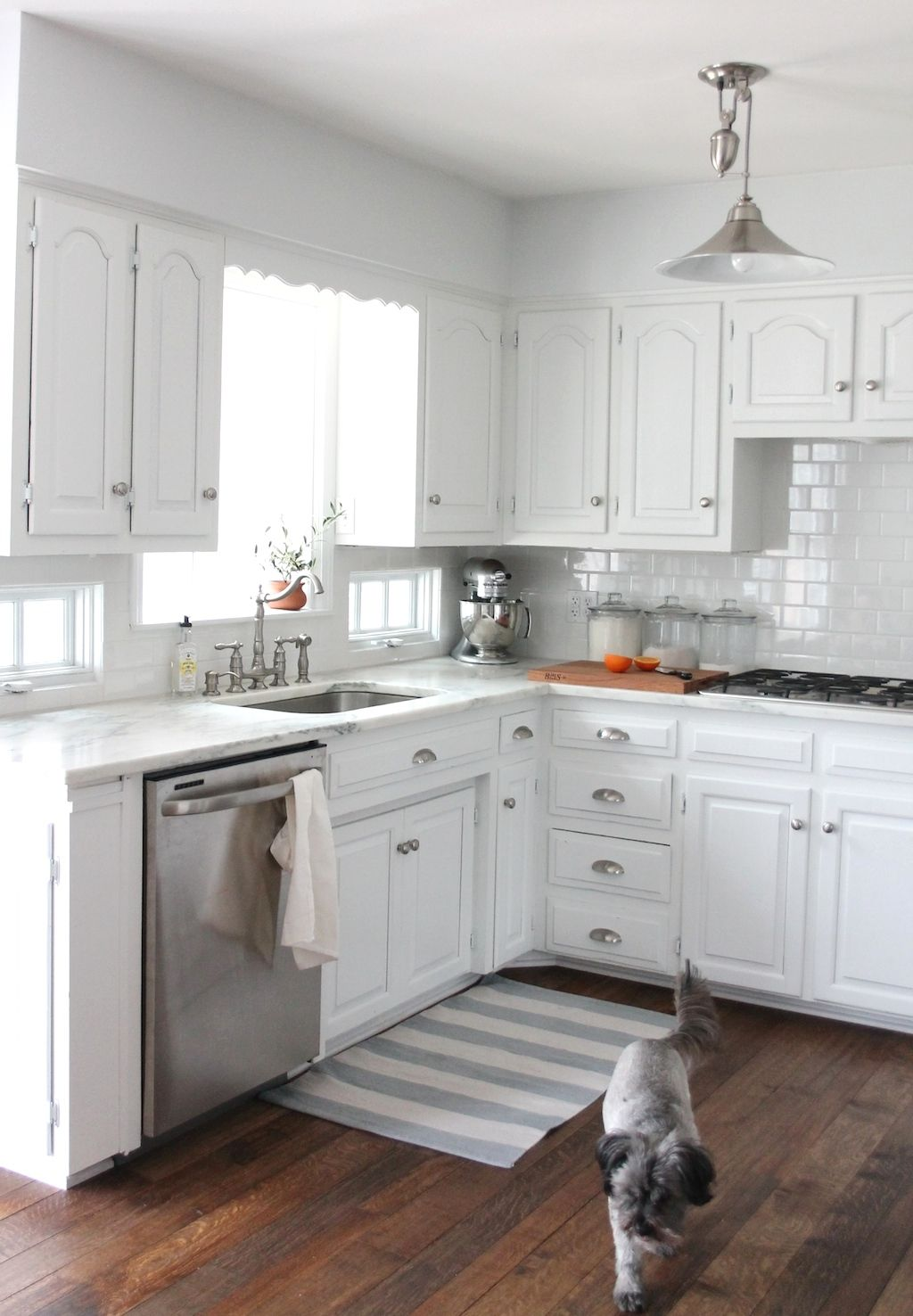 Small Kitchen With White Cabinets And Stainless Steel Appliances