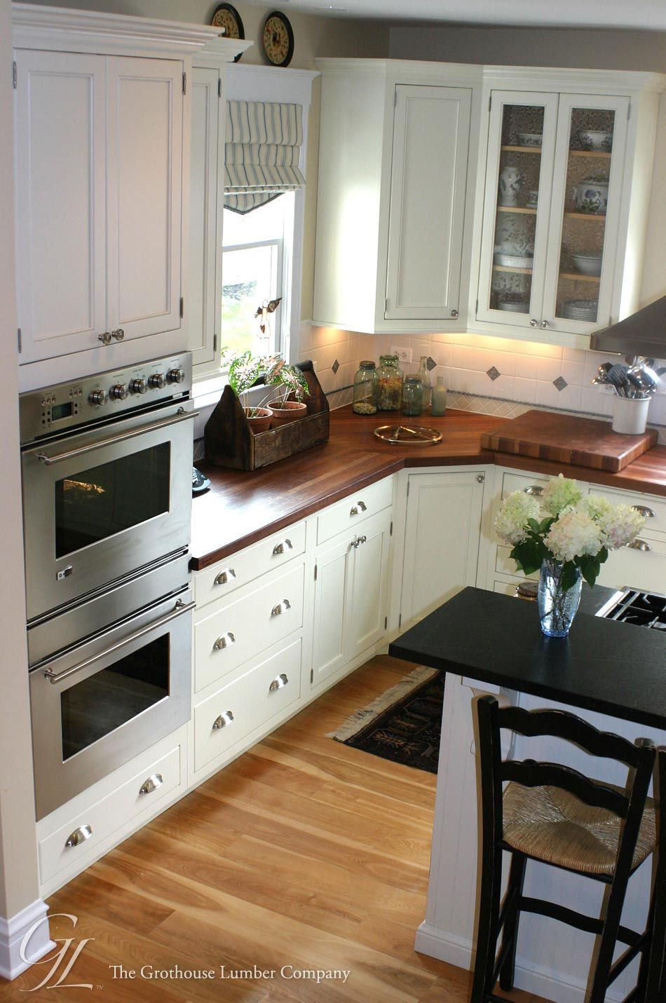 Kitchens With Wood Cabinets And Black Countertops