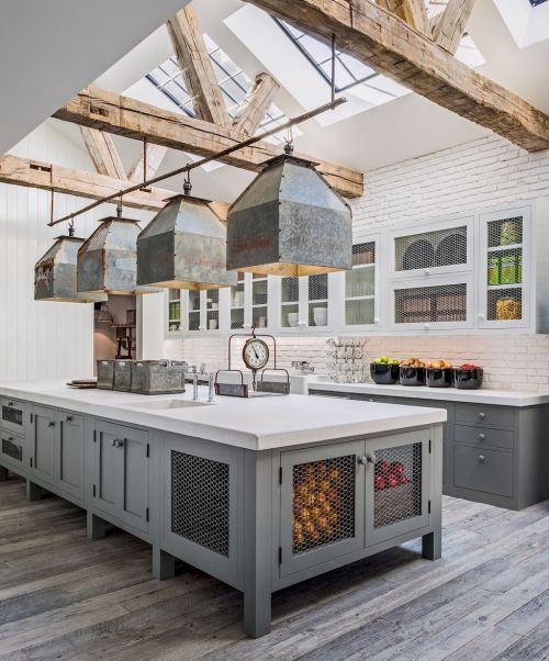 Farmhouse kitchen with galvanized metal lighting and chicken wire cabinet doors