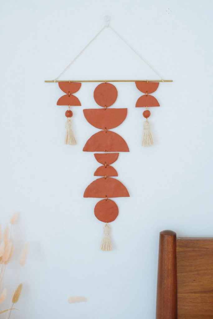Boho clay wall hanging DIY decor in a terracotta color.