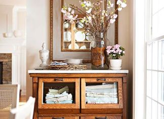 Lend farmhouse charm to your dining room with a grain bin repurposed as a buffet. The deep drawers are suited for storing linens and party staples, such as candles and special occasion china! http://www.bhg.com/decorating/storage/projects/from-flea-market-finds-to-savvy-storage/?socsrc=bhgpin041615fleamarketstorage&page=16