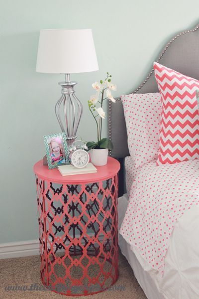 Painted trash can turned over as side table.  I would use outdoor paint, for outdoor table.