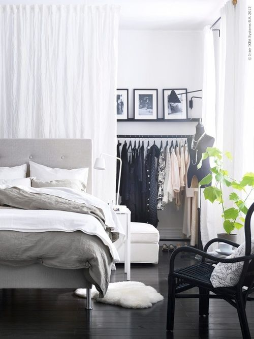 Drapery as a divider for a closet area: