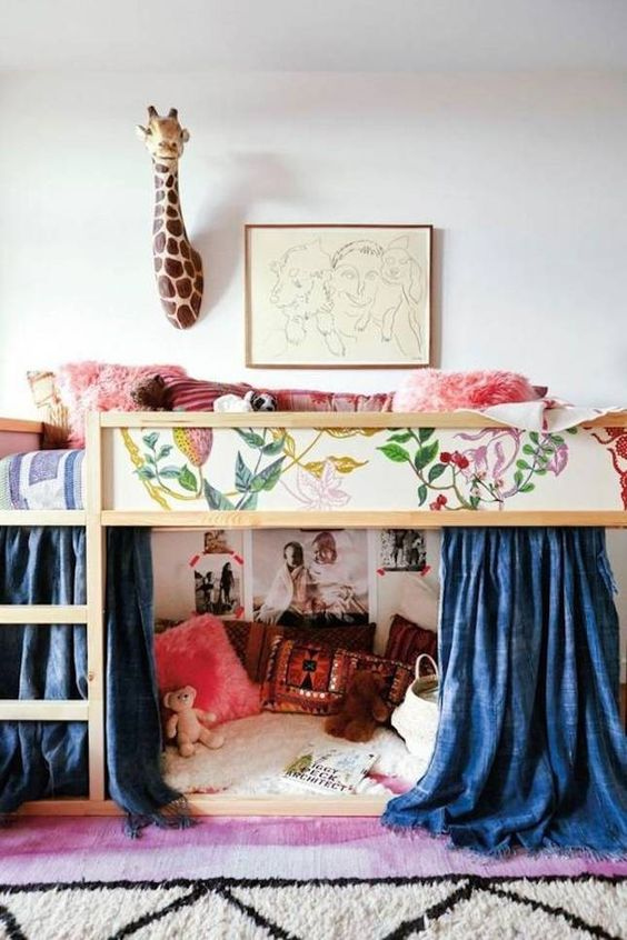 Upgrade your child's bed panels like this creative parent did using scraps from floral wallpaper. This is just one of the many creative kids room ideas.: