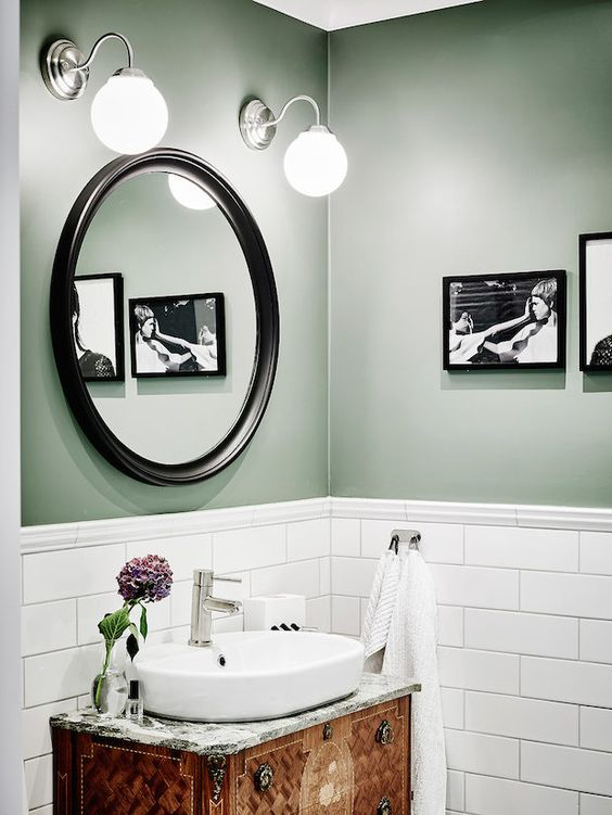 Bathroom with green walls, white subway tiles and antique vanity in a beautiful Swedish home in calm, muted tones. Entrance, Anders Bergstedt.: