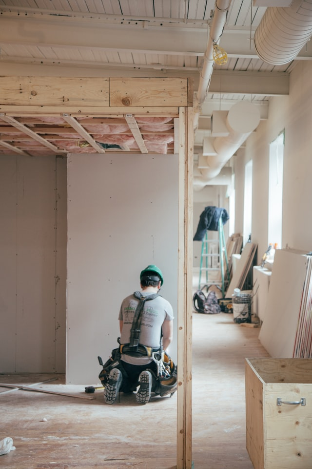 Man renovating a room in the house